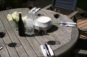 the table is set for outdoor dining