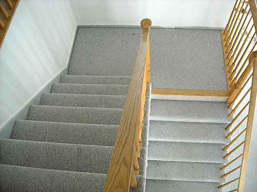 stairs before with berber carpet