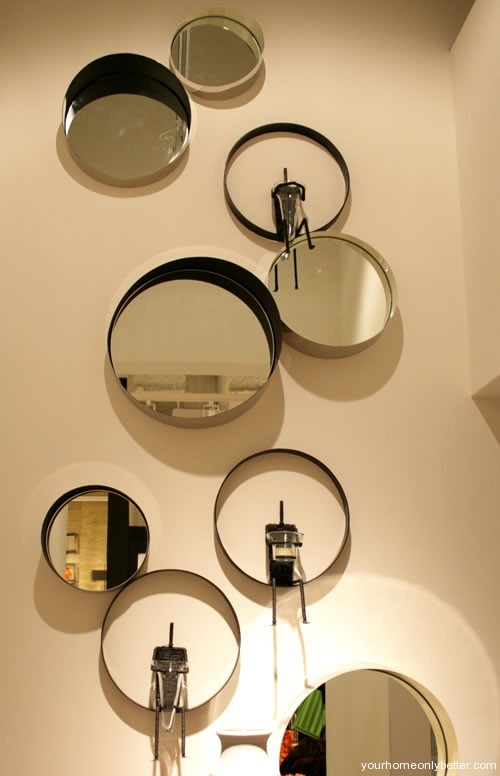 bowls mirrors and plates as wall art