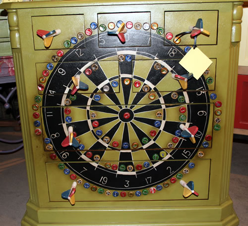 game of darts painted on dresser
