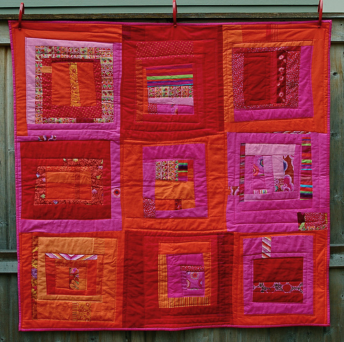 This red and bright pink quilt is a great example of color trends and combos for 2013