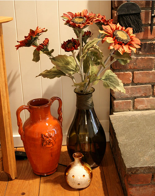 grouping of orange and green vases