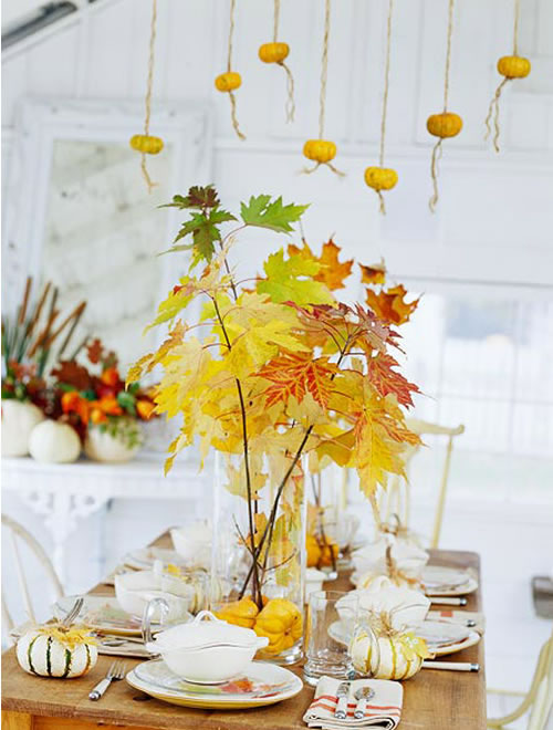 mini pumpkins hanging with twine
