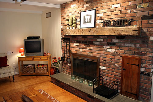 brick fireplace in family room