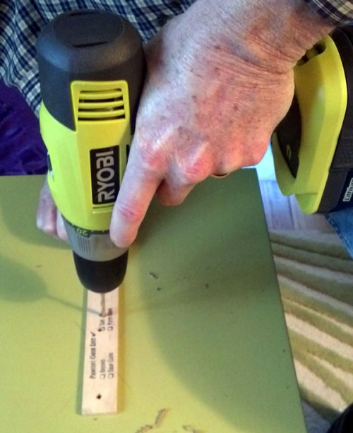 drilling holes in cabinet