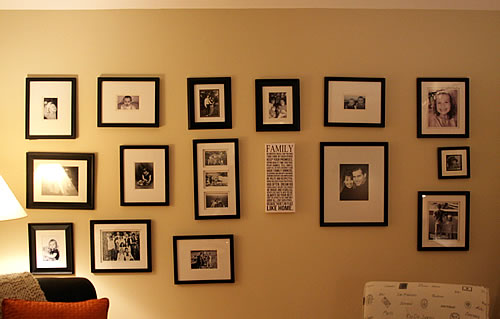 family photos arranged on living room wall