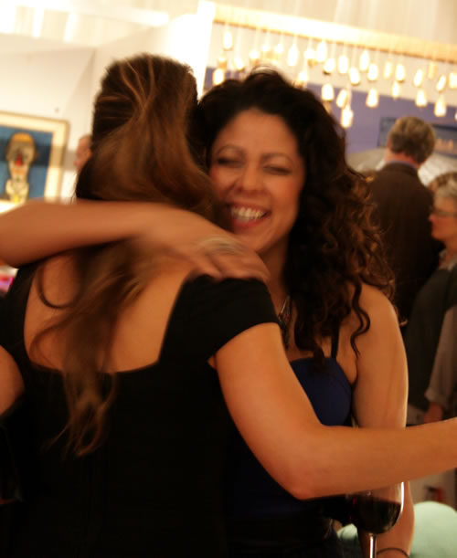 Sabrina Soto and Evette Rios hugging at design on a dime