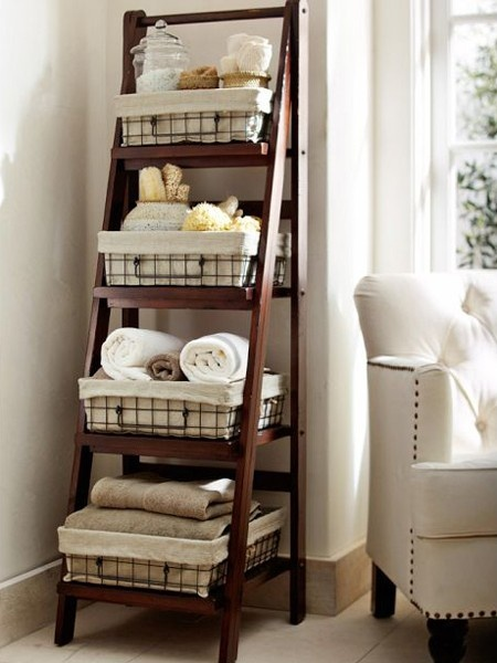 ladder repurposed as linen storage