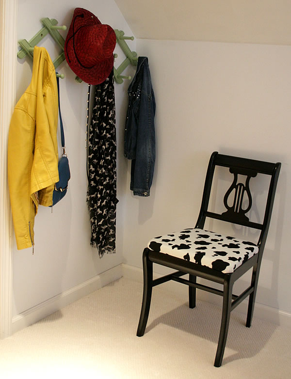chair upcycled with black paint and cow print fabric