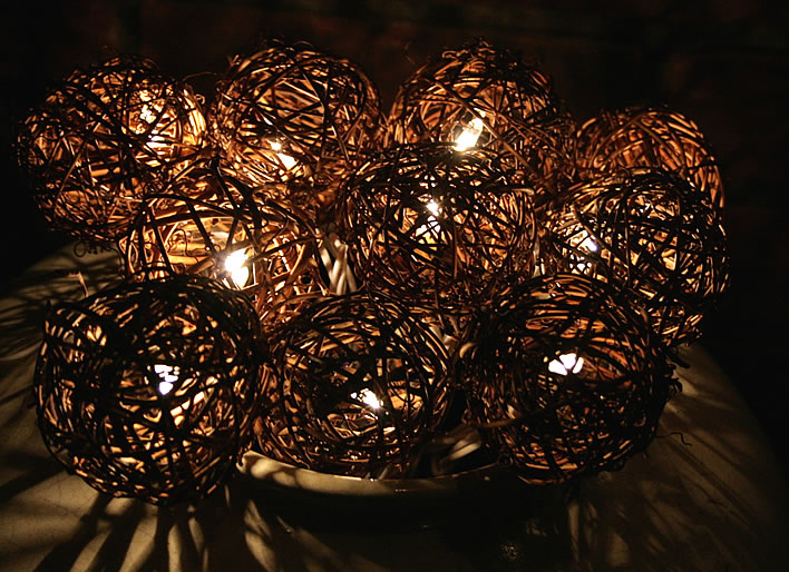 holiday string lights and grape orbs in a pot #diy #decor #yourhomeonlybetter