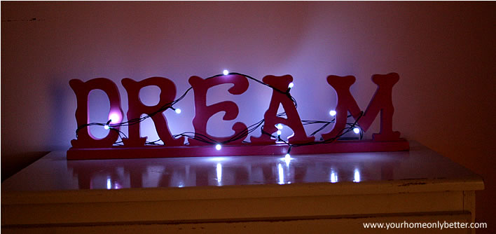 string lights wrapped around headboard #pink #girlsroom #diy #decor #yourhomeonlybetter